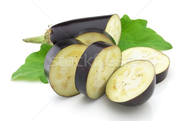 Cut aubergine Stock photo © Dionisvera