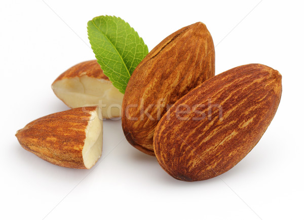 Almonds kernel with leaves Stock photo © Dionisvera