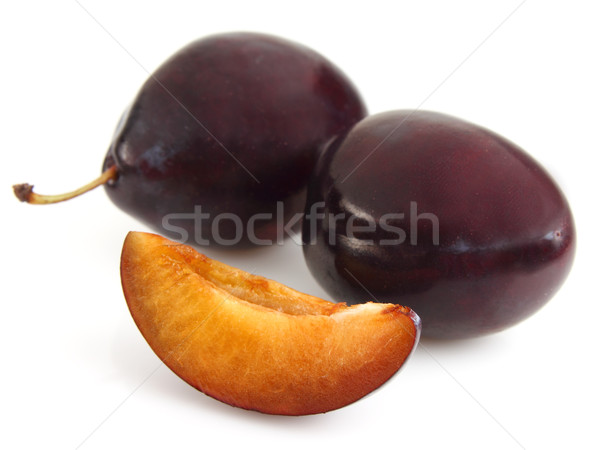 Sweet plums with slice Stock photo © Dionisvera
