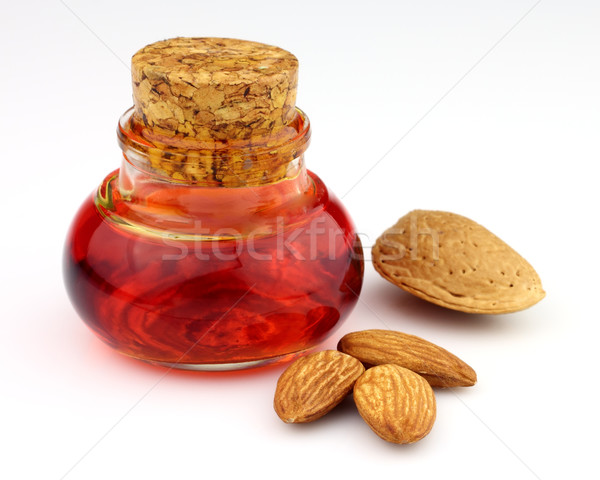Almonds oil with kernel Stock photo © Dionisvera