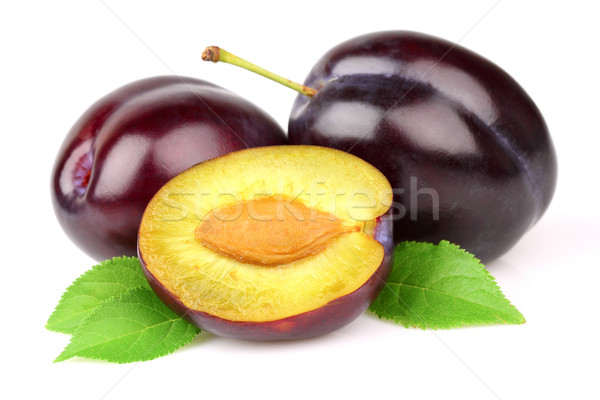 Ripe plums with leaves Stock photo © Dionisvera