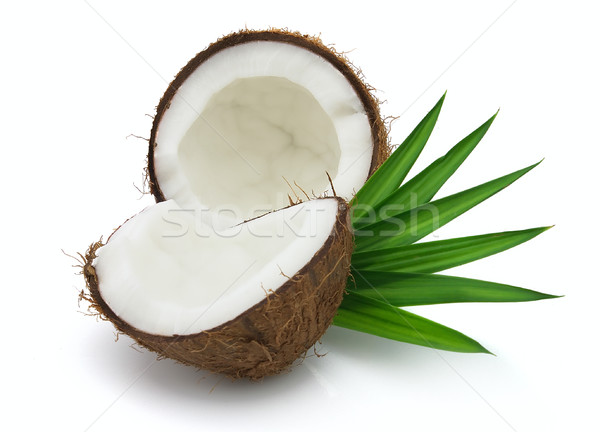 Coconut with leaves Stock photo © Dionisvera