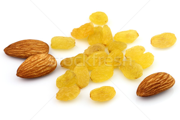 Almonds kernel with raisins Stock photo © Dionisvera