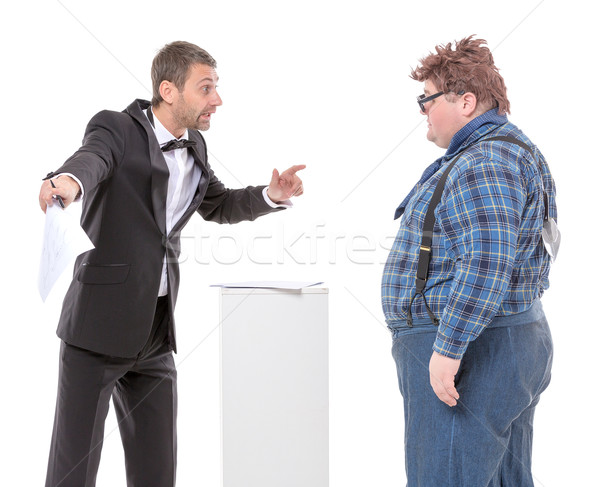 Elegant man arguing with a country yokel Stock photo © Discovod