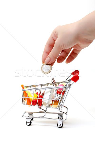 Stockfoto: Winkelwagen · hand · munt · witte · business · achtergrond