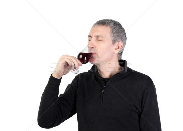 Man tries a glass of red port wine Stock photo © Discovod