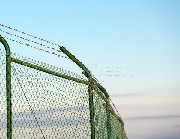 Mesh fence with barbed wire Stock photo © Discovod