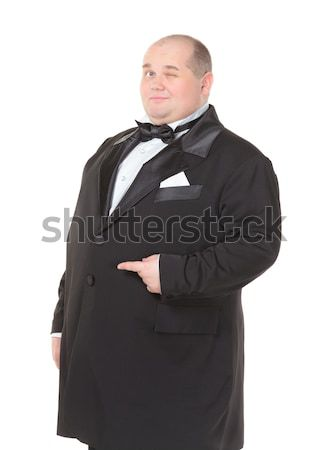 Elegancki grubas muszka wskazując obiedzie kurtka Zdjęcia stock © Discovod