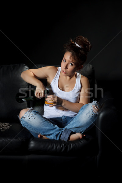 Woman pouring a alcohol drink Stock photo © Discovod