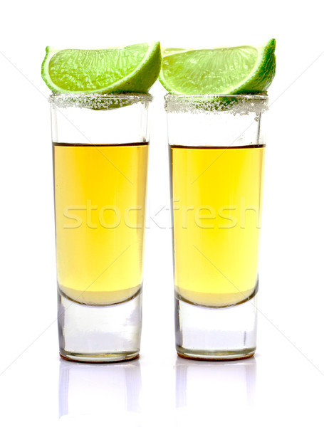 Tiro ouro tequila fatia cal branco Foto stock © Discovod