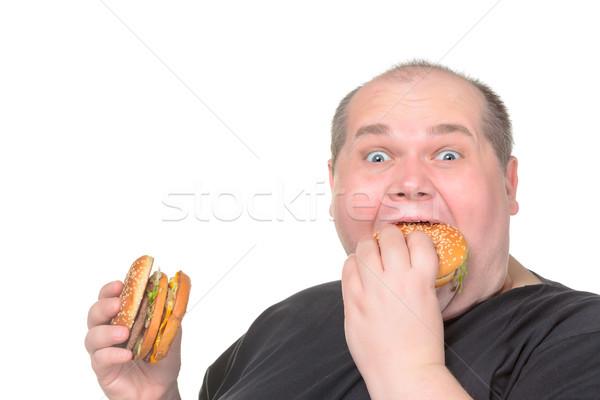 Fat Man Greedily Eating Hamburger Stock photo © Discovod