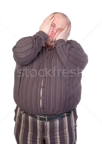Obese man squashing his face Stock photo © Discovod