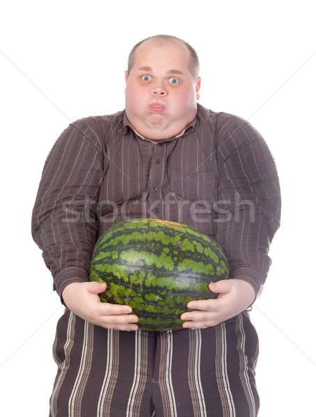 Fat man struggling to hold the weight of a whole watermelon Stock photo © Discovod