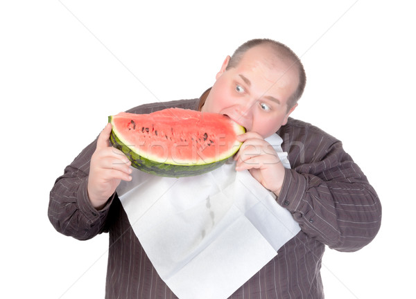 Fat man tucking into watermelon Stock photo © Discovod