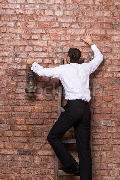 Man up against a brick wall Stock photo © Discovod