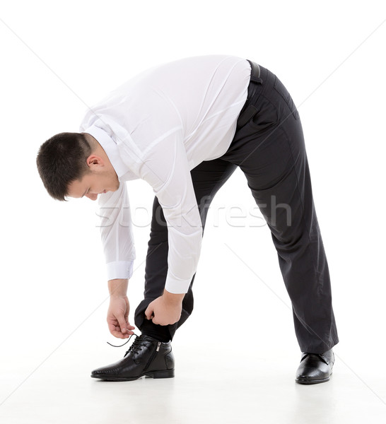 Man bending down to do up his shoelaces Stock photo © Discovod