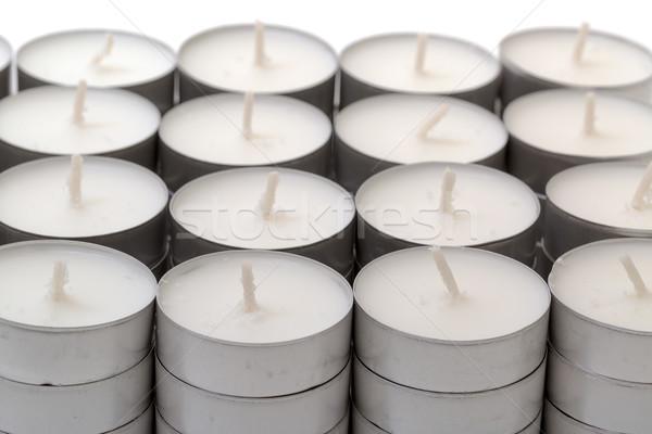 Sorok fehér viasz tea fény gyertyák Stock fotó © Discovod