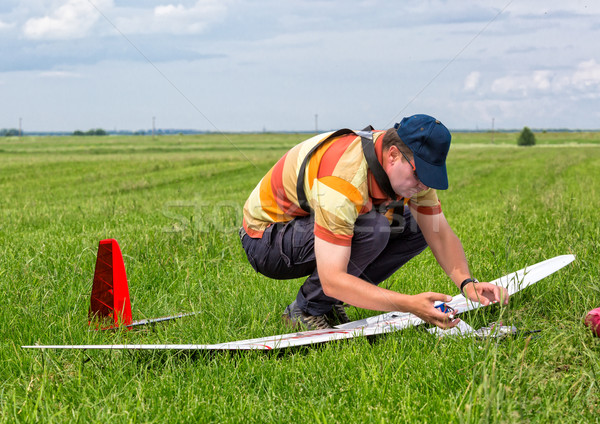 Man makes the assembly RC glider Stock photo © Discovod