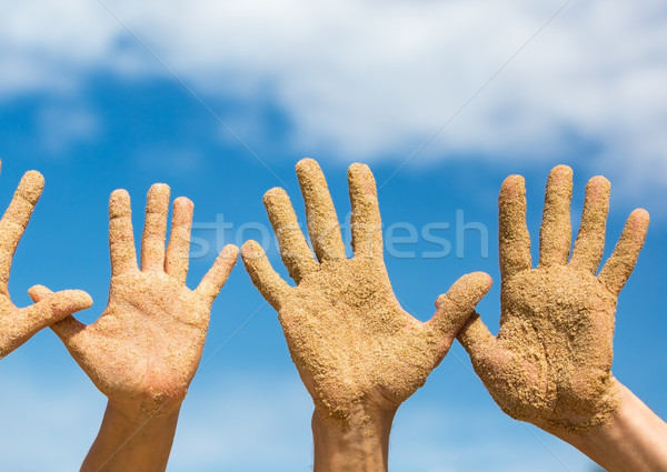 Woman and Man Shows his Open Hands Covered with Beach Sand Stock photo © Discovod