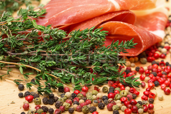 Dry thyme, multicolored peppercorn and hamon Stock photo © Discovod