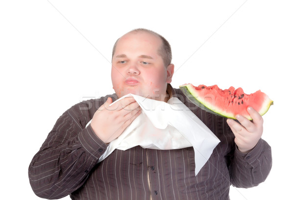 Obese man eating watermelon Stock photo © Discovod