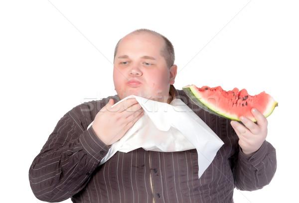 Fettleibig Mann Essen Wassermelone herum Hals Stock foto © Discovod