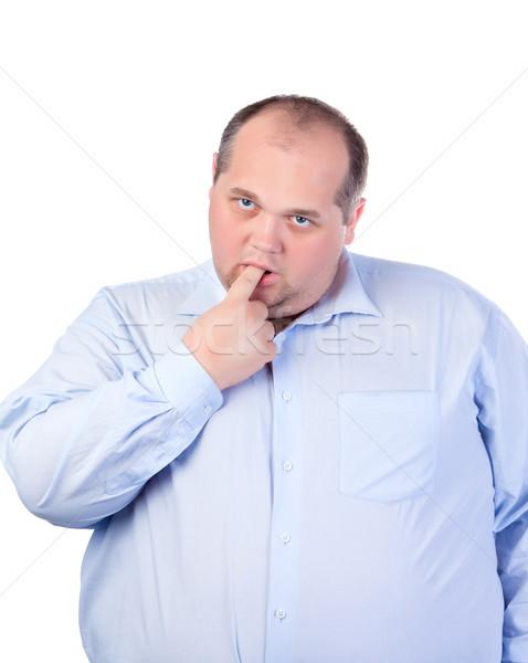 Grubas niebieski shirt człowiek biały palec Zdjęcia stock © Discovod
