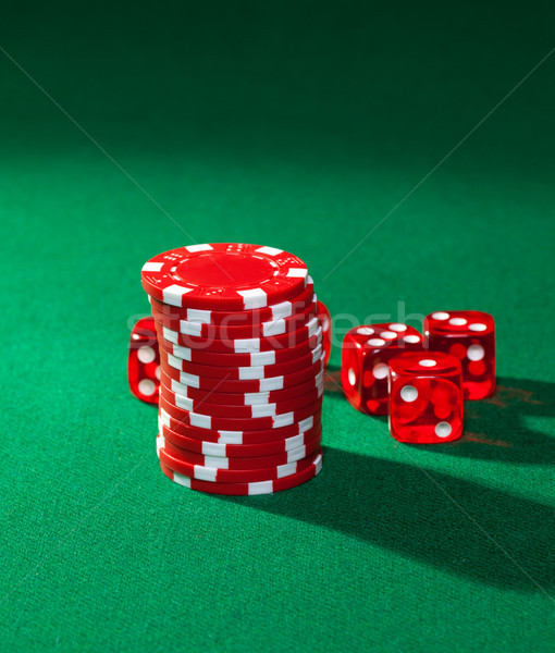 Red poker chips and red dice Stock photo © Discovod
