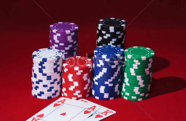 Stacks of Poker Chips with Playing Cards Stock photo © Discovod