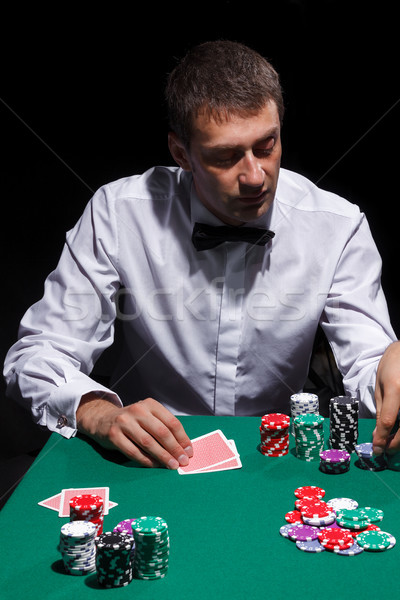Gentleman in white shirt, playing cards Stock photo © Discovod