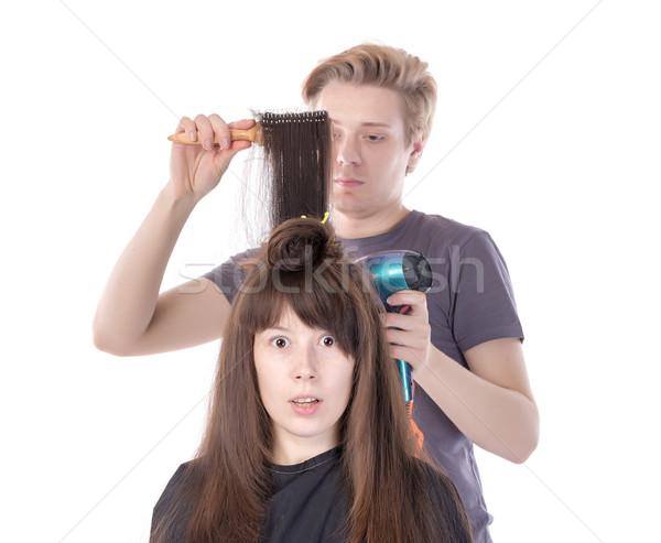 Woman enjoying having her hair blow dried Stock photo © Discovod