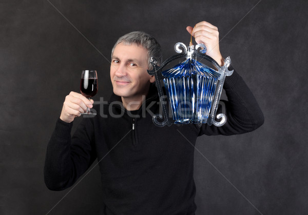 Man holding a glass wine and lantern Stock photo © Discovod