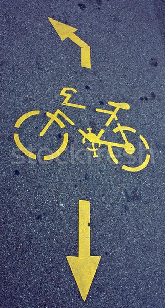 Bisiklet imzalamak çim yol çalışmak ok Stok fotoğraf © Discovod