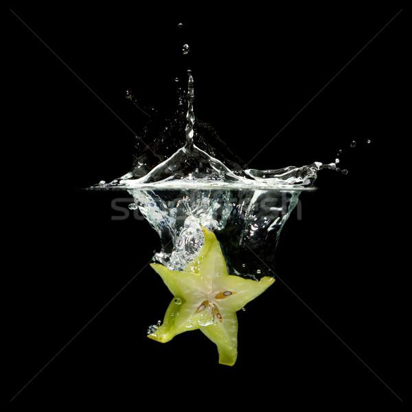carambola splashing in water Stock photo © Discovod