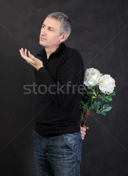 Man hiding a bouquet of flowers Stock photo © Discovod