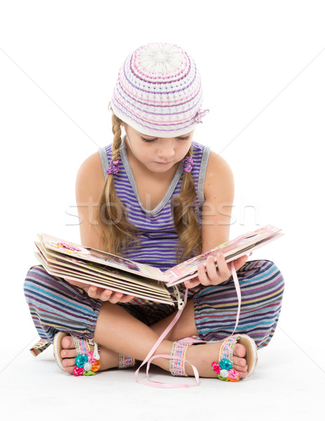 Little Girl Looking Album Sitting on the Floor Stock photo © Discovod