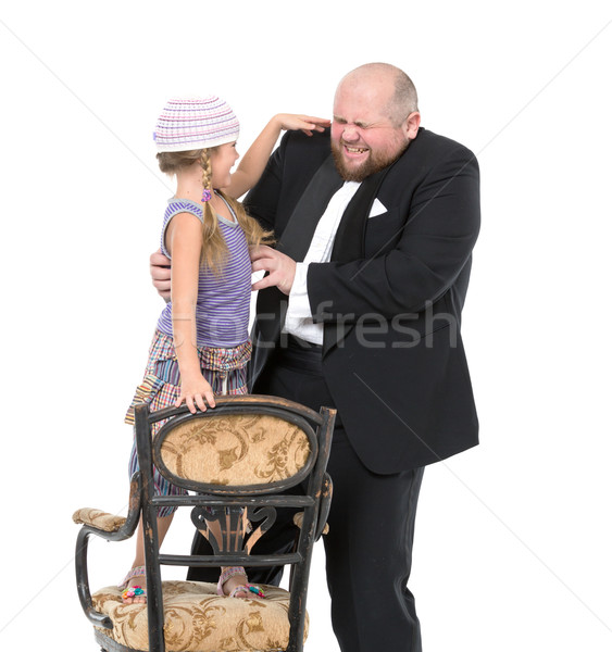 Little Girl and Servant in Tuxedo Have Fun Stock photo © Discovod