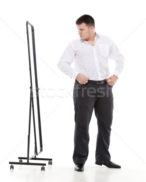 Overweight man admiring himself in a mirror Stock photo © Discovod