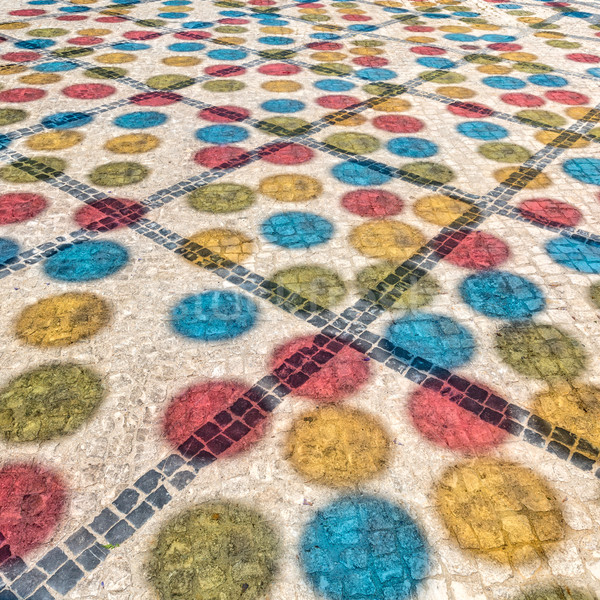 Multicolored Shadows from Decorative Balls on Paving Stone Stock photo © Discovod