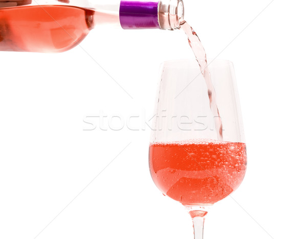 Pink Wine Pouring into Glass Stock photo © Discovod