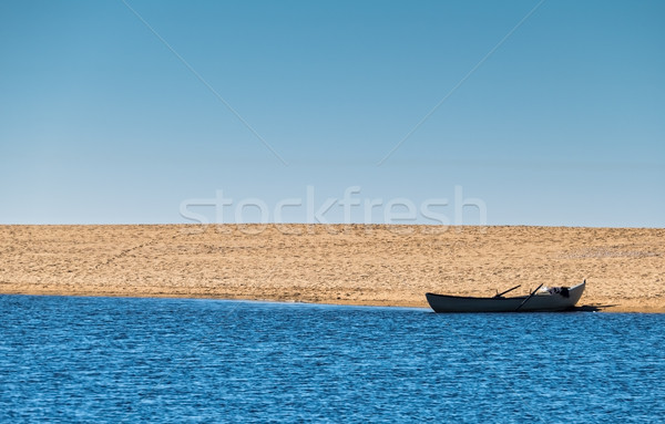 Solo Rowboat Moored on Sandy Beach Stock photo © Discovod