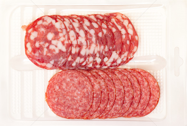 Slices Salami in container Stock photo © Discovod