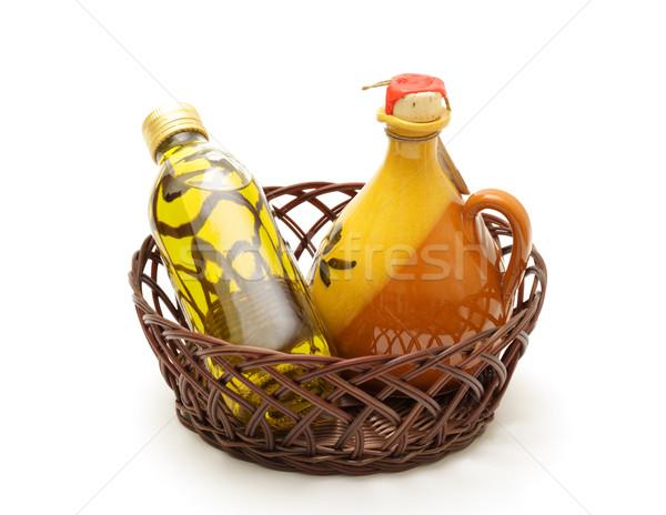 Bottle and jar of virgin olive oil in basket Stock photo © Discovod
