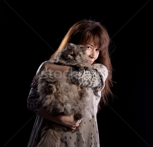 Young beautiful smiling woman holds fluffy cat Stock photo © Discovod