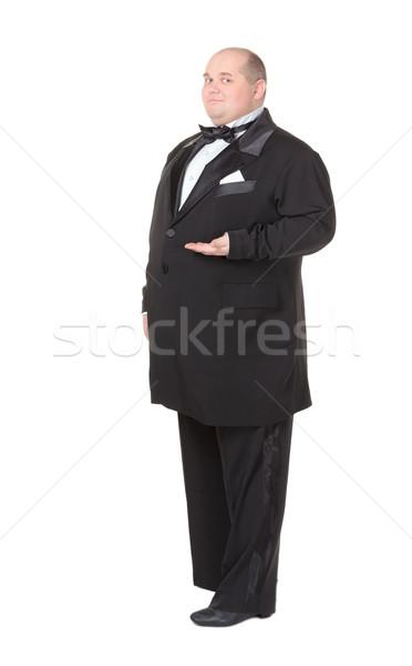Elegáns kövér férfi csokornyakkendő mutat vacsora kabát Stock fotó © Discovod
