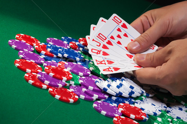 Stock photo: Colorful poker chips and royal flush