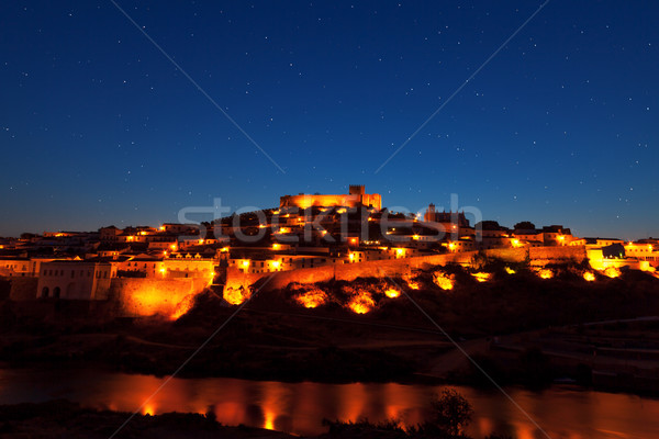 Walled town illuminated at night Stock photo © Discovod