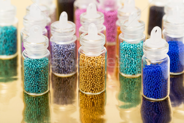 Small Glass Jars filled with Balls of Bead Stock photo © Discovod