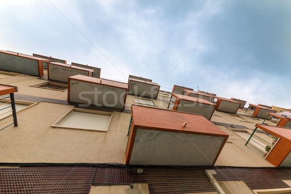 Balconies Old Apartments on cloud sky background Stock photo © Discovod