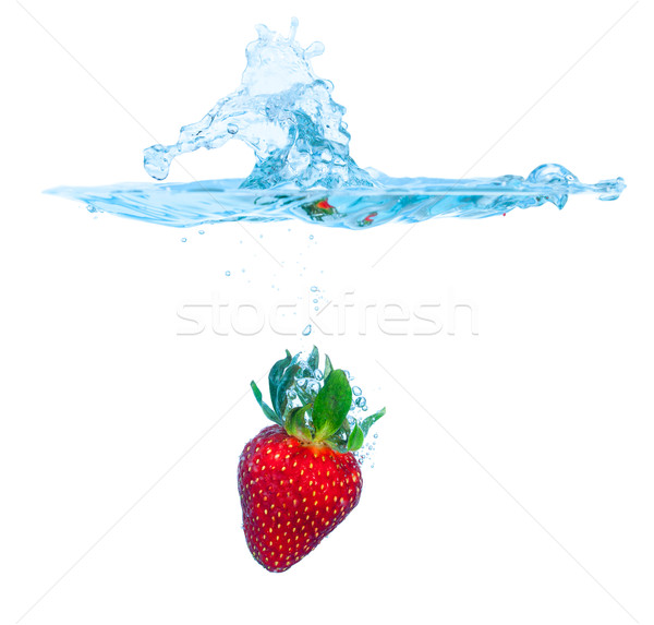 Fresh Strawberry Dropped into Water with Splash Stock photo © Discovod